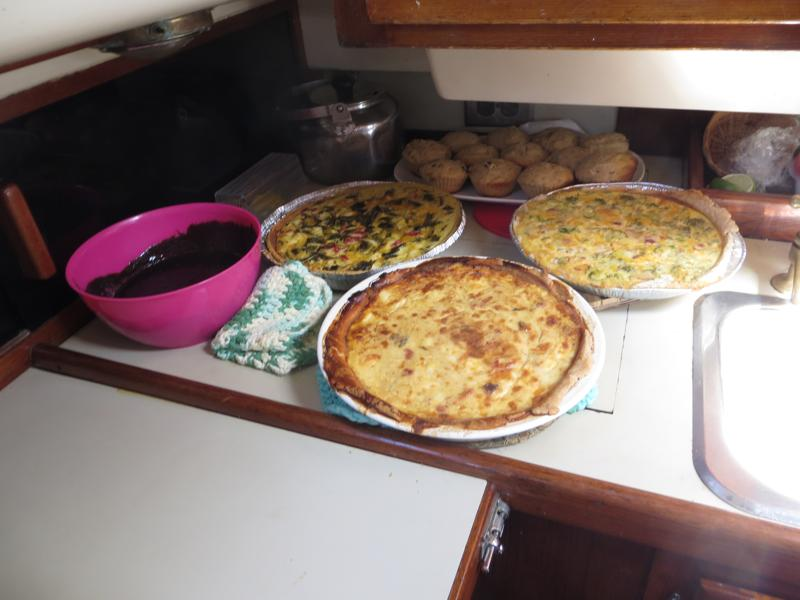 Three variations of lobster quiche and banana muffins topped with chocolate pudding for dessert